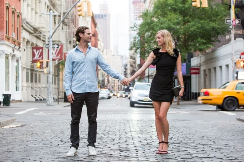 Couple holding hands and standing in a street in the SoHo neighbourhood of New York City, USA