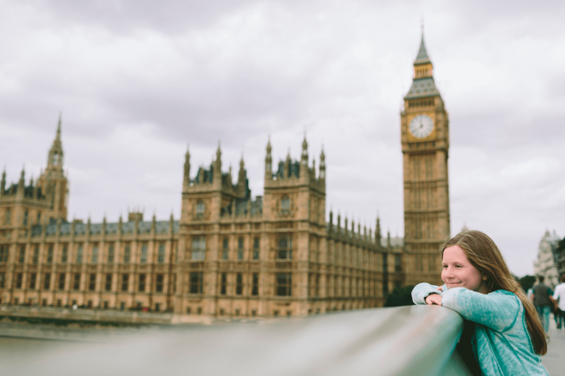 Young girl overlooking the Thames river with Big Ben in the background in London, UK