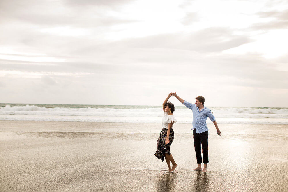Couple dancing together on the sandy shore of Seminyak Beach, Bali
