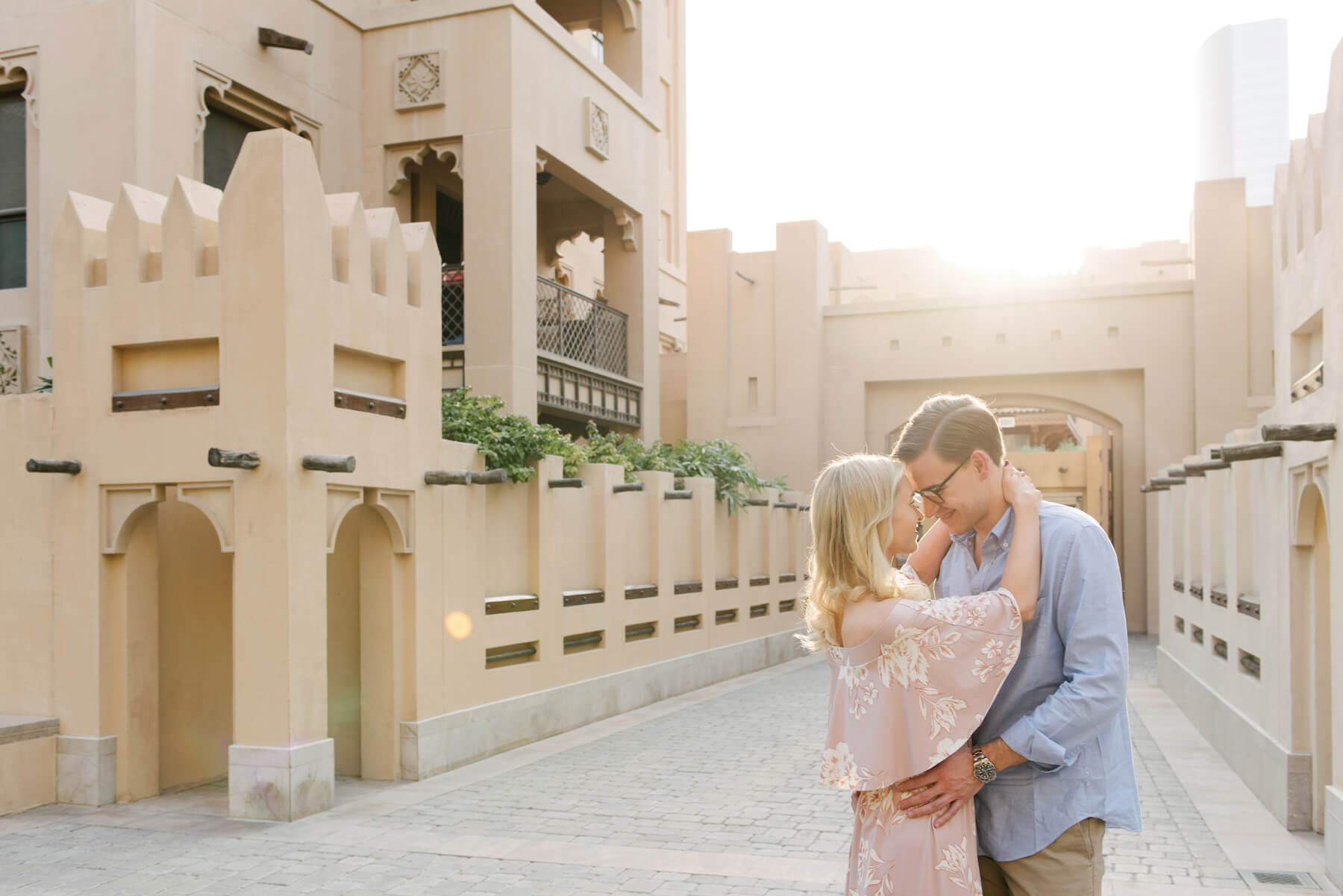 Couple hugging each other and smiling on a couples trip in Old Dubai, Dubai United Arab Emirates