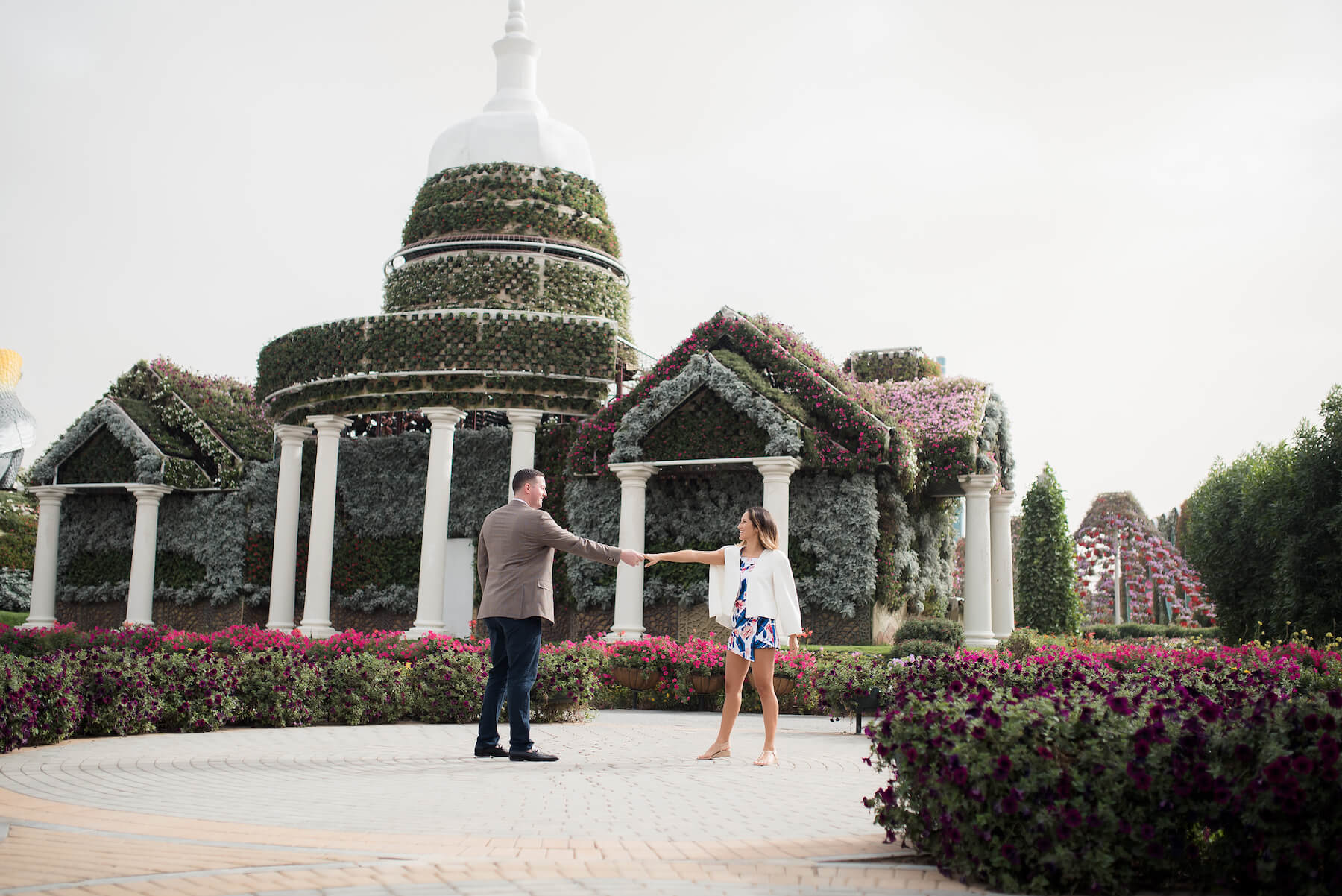 Couple dancing together in the Dubai Miracle Garden
