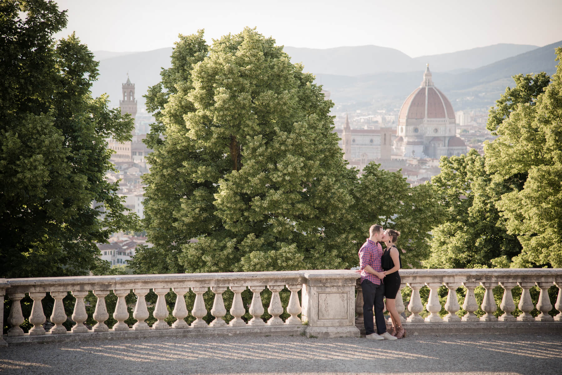 Couple kissing with the city of Florence, Italy in the background