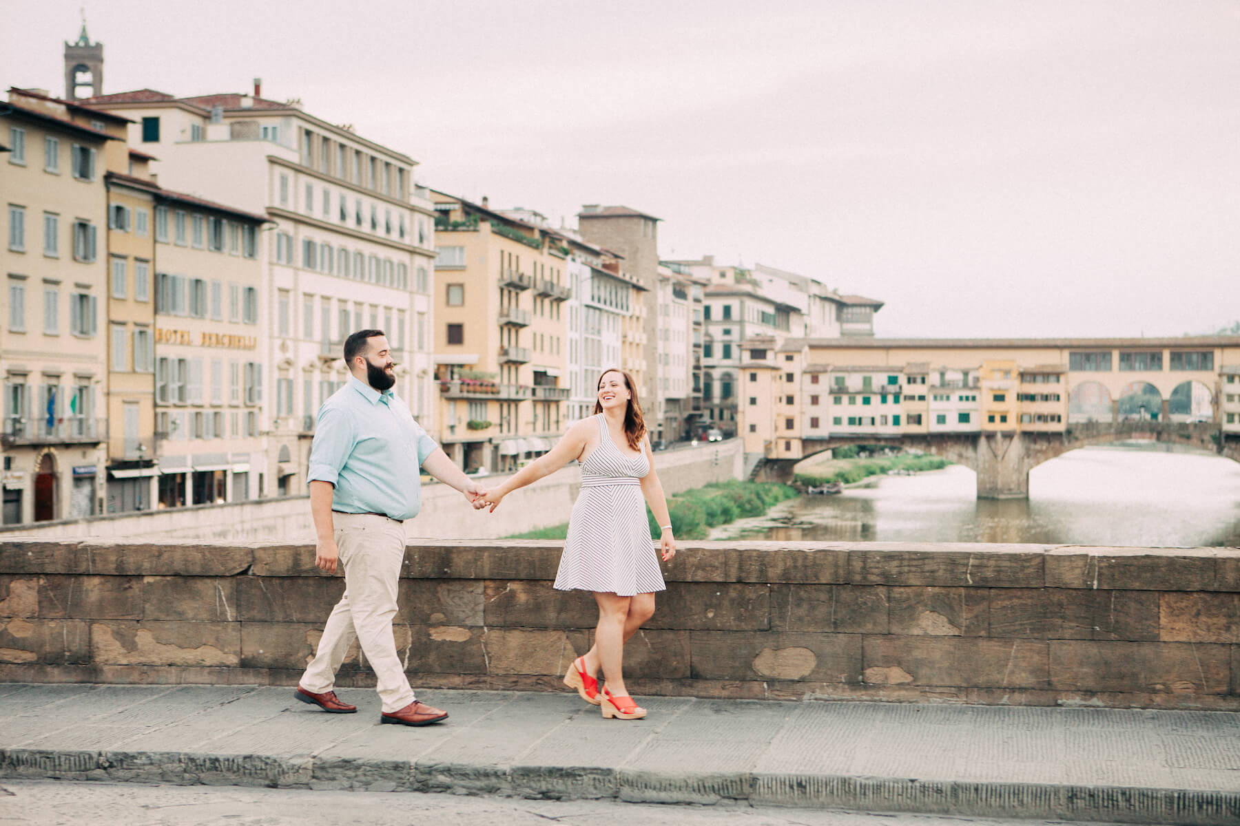 Couple walking in Florence, Italy