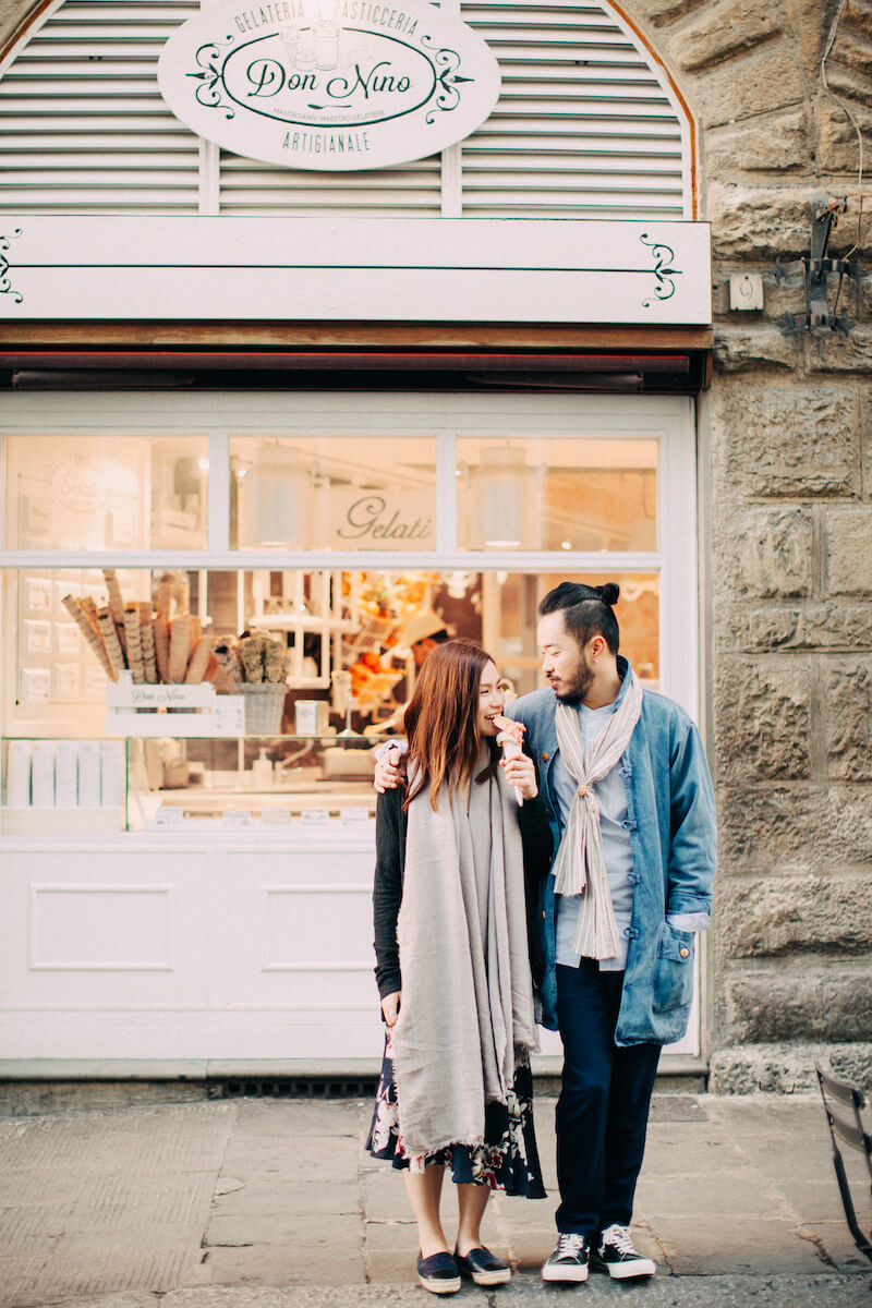 Couple standing together in front of Don Nuno gelato shop on couples trip in Florence, Italy