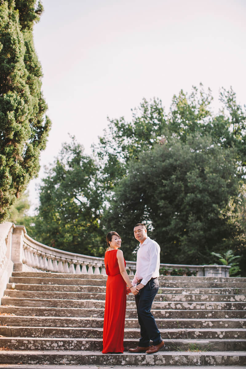 Asian couple standing on steps together in Florence, Italy