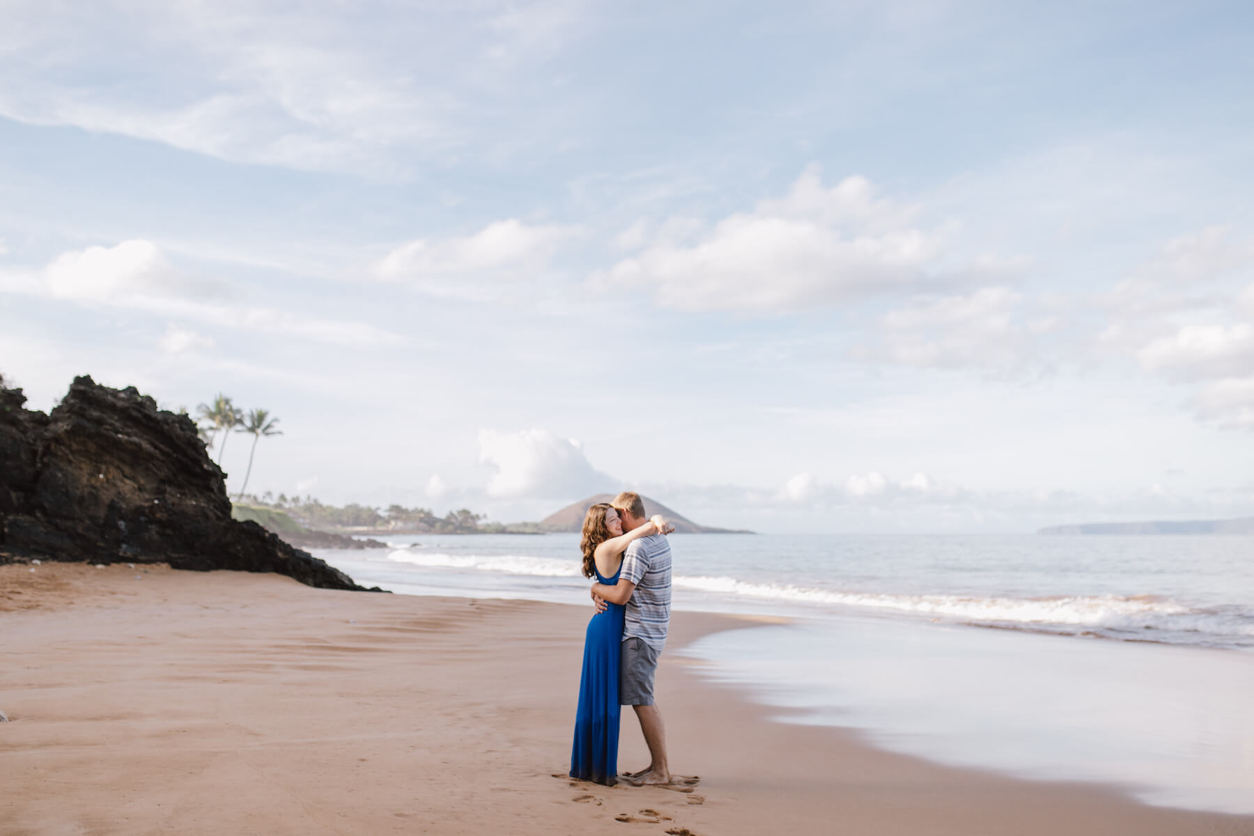 couple hugging on the beach in Maui, Hawaii, USA