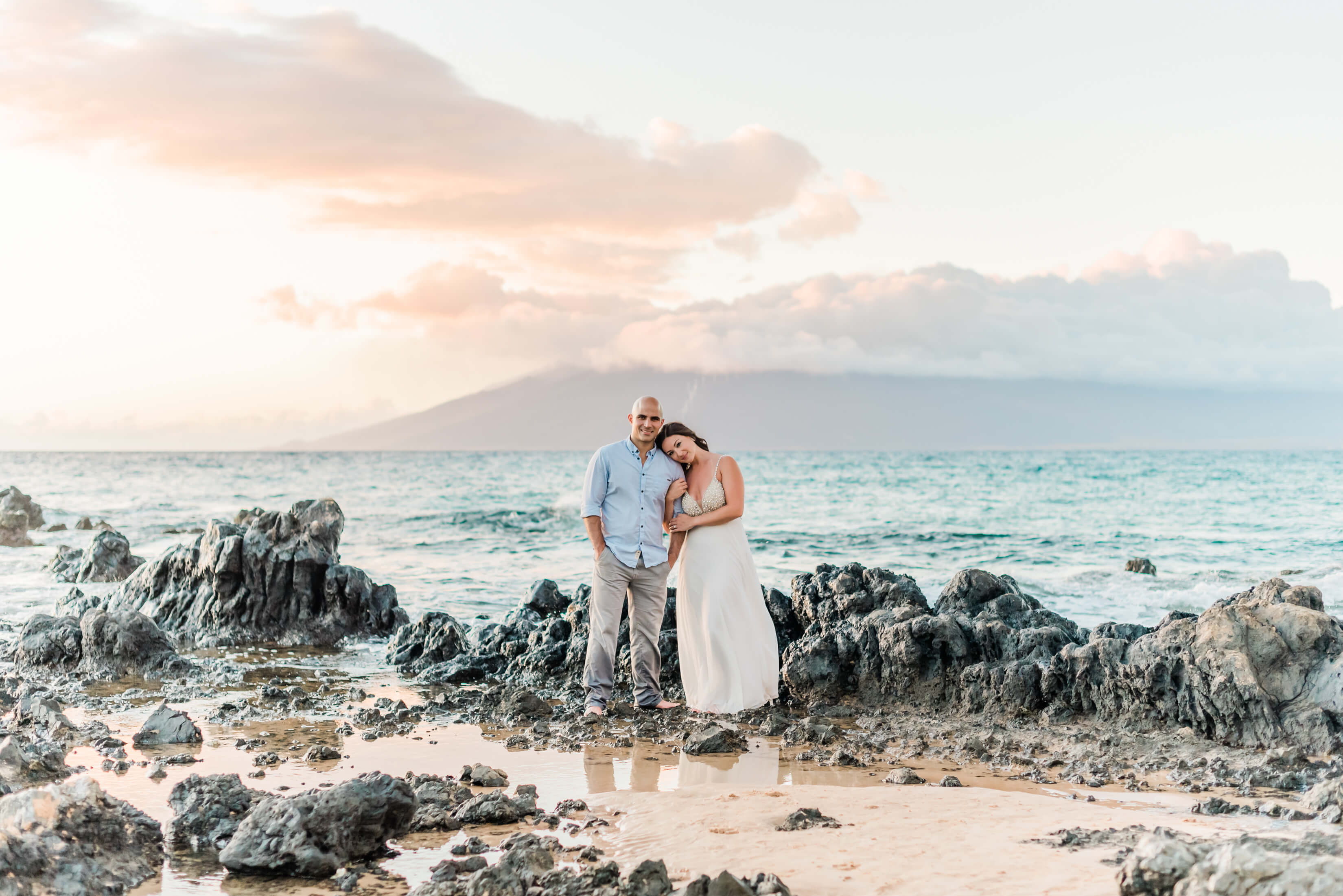couple standing on the beach shoreline in Maui, Hawaii, USA