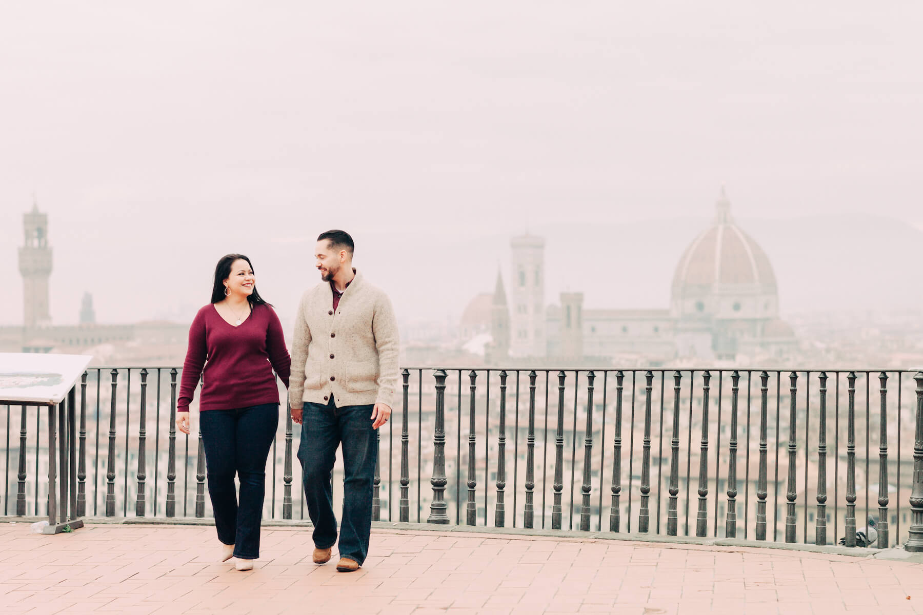 Couple looking lovingly at each other on a trip together at Piazzale Michelangelo in Florence, Italy