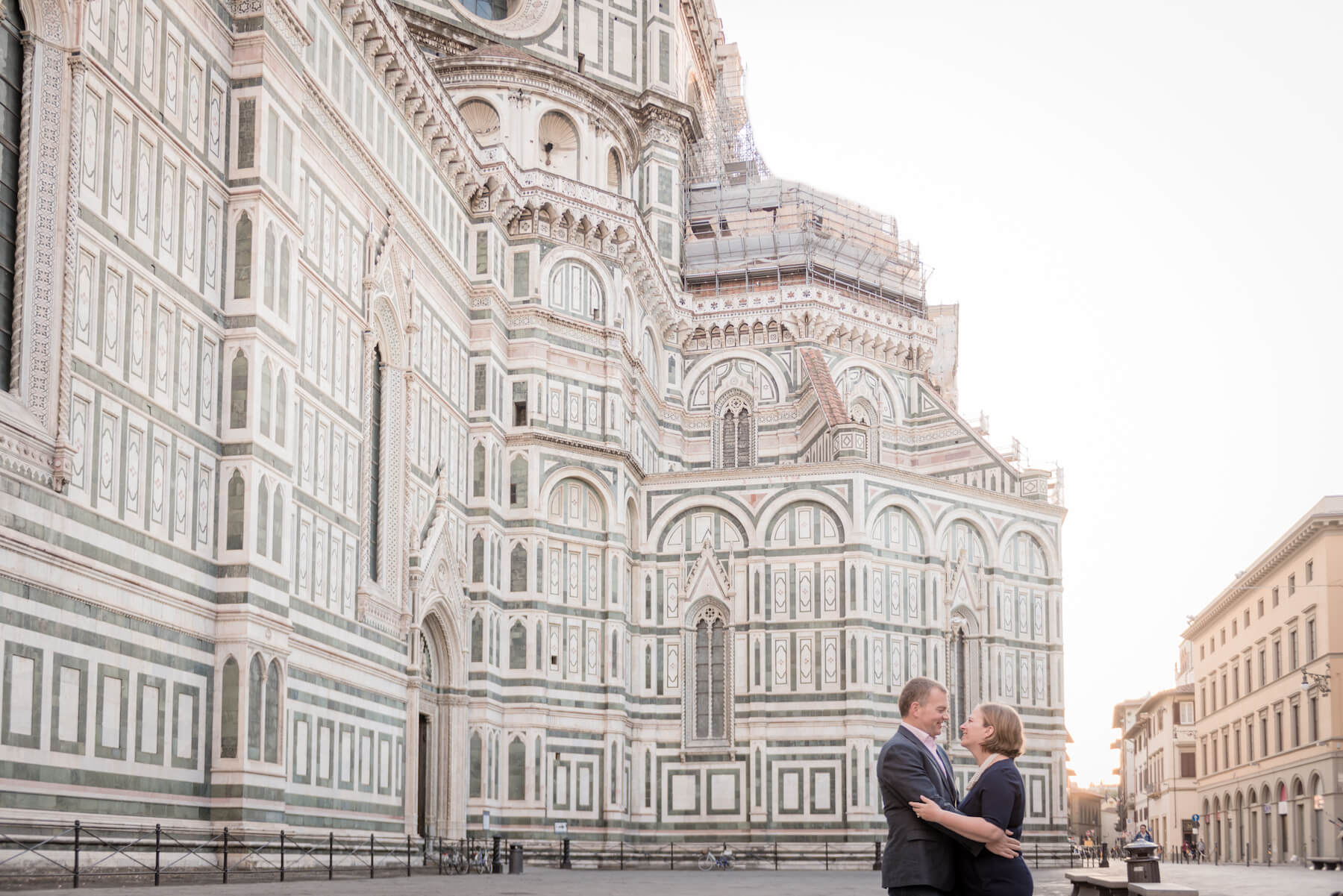 Mature couple hugging each other in front of The Duomo on a couples trip in Florence, Italy