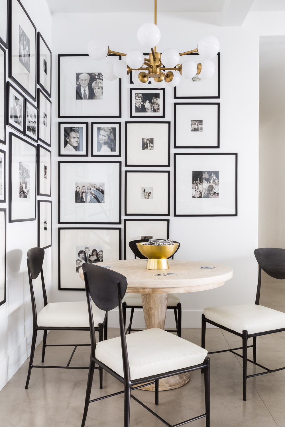 Gallery wall of photos in dining room