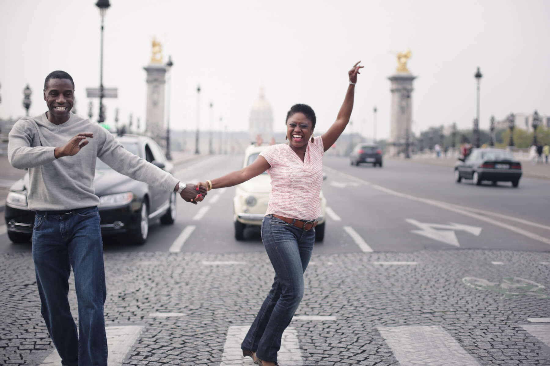 Couple dancing together in an intersection in Paris, France