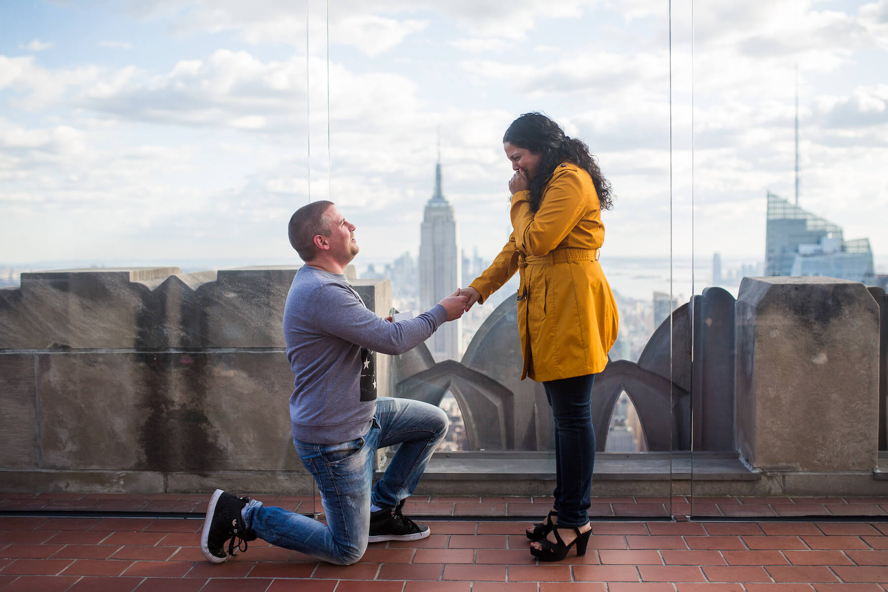 Man proposing to his partner as his partner is crying happy tears in New York City, New York USA