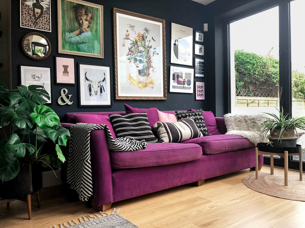 Purple couch and gallery wall in a home