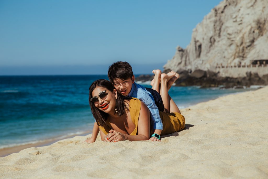 Mom and son smiling on the beach in Cabo san Lucas