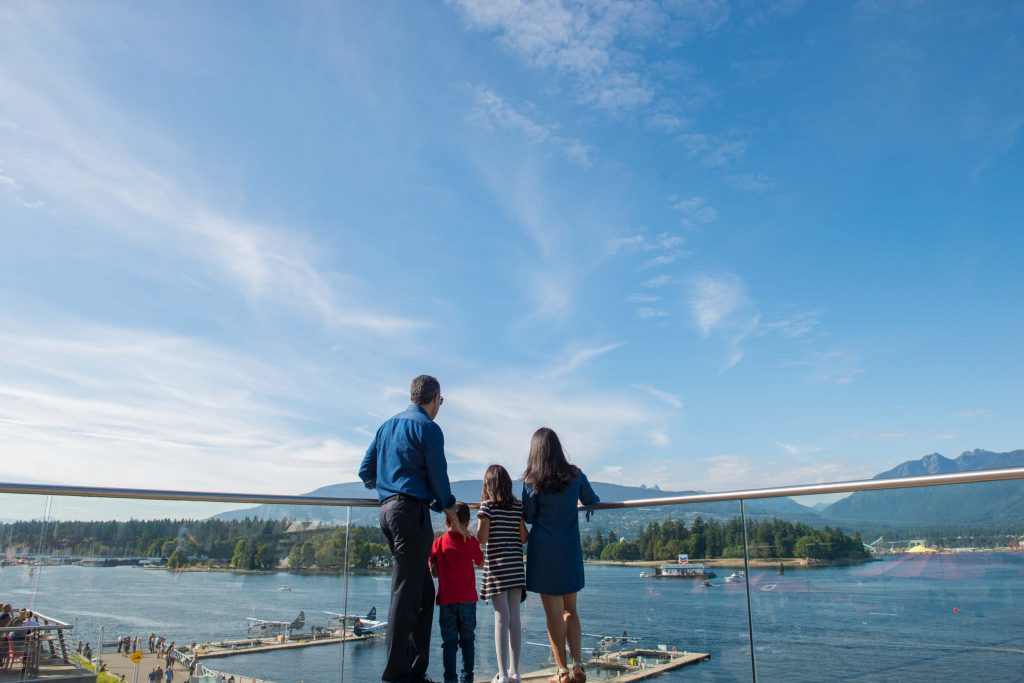 A family looks out over the water to Vancouver Island.