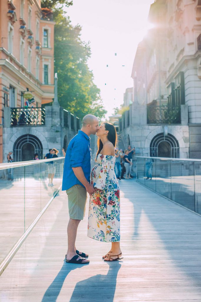 A couple kisses on a bridge in Ljubljana