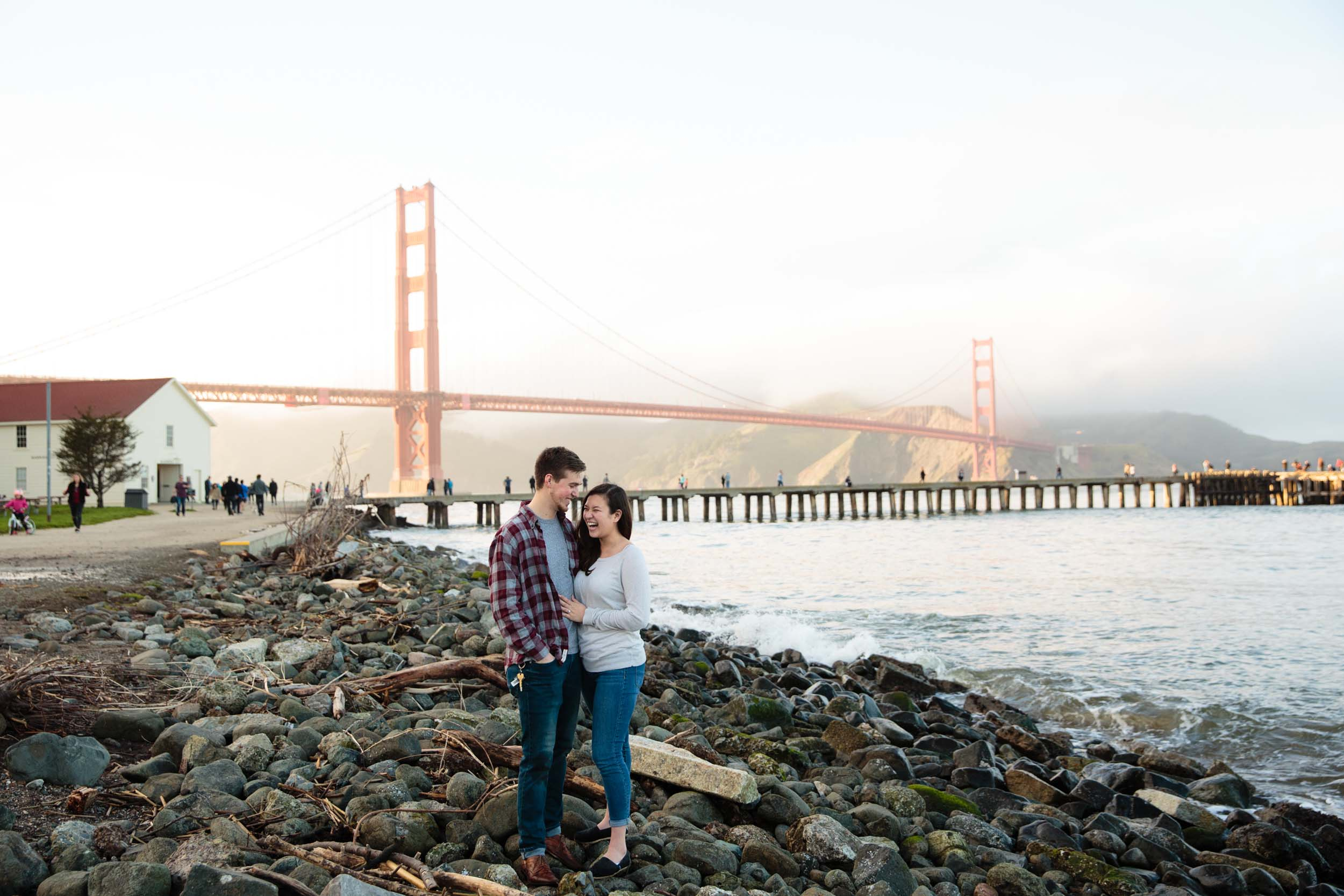 A couple embraces in front of the Golden Gate Bridge in San Francisco.