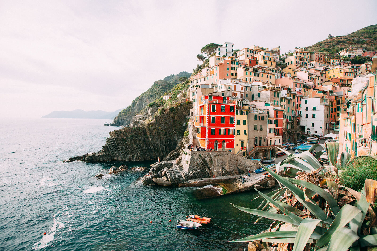 Cinque Terre coastline with colourful houses perched along the cliffs in Italy