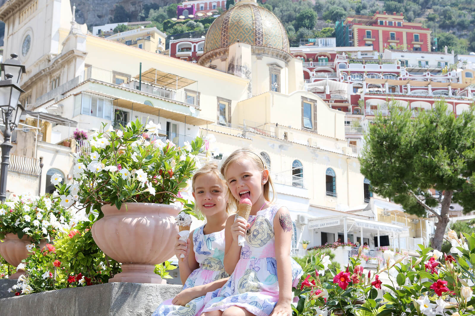 Young girls eating ice cream together in Amalfi Coast, Italy