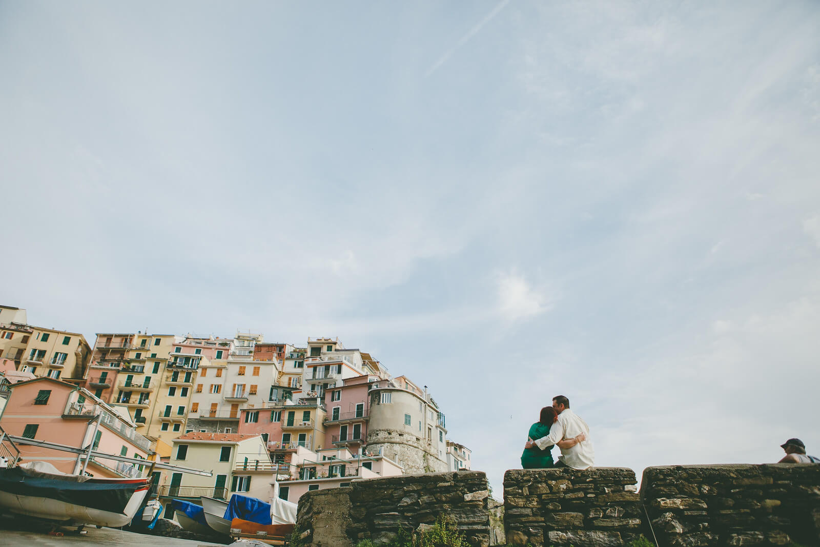 Man kissing his partner's forehead in Cinque Terre, Italy