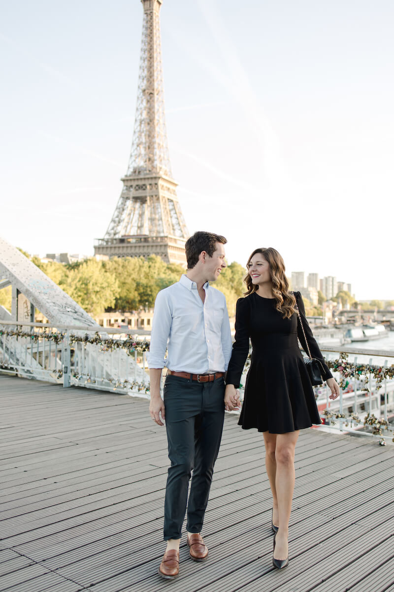 couple trip, girl wearing a black form fitting dress in Paris, France