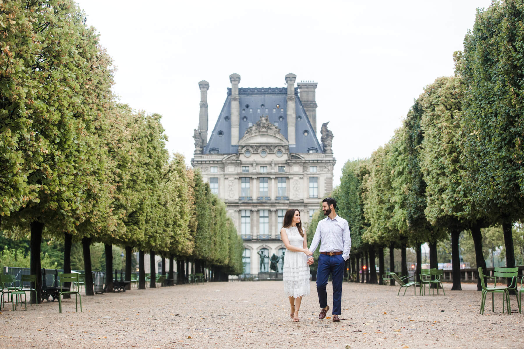 Couple walking in the park on a couples trip in Paris, France