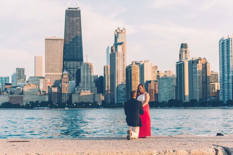 Man proposing to his partner with downtown Chicago in the background