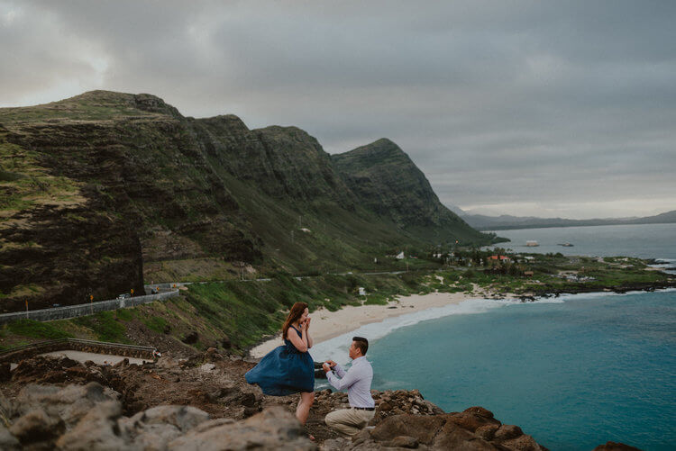 Woman shocked and happy at her partner's surprise proposal at Lanai Lookout in Honolulu, Hawaii USA