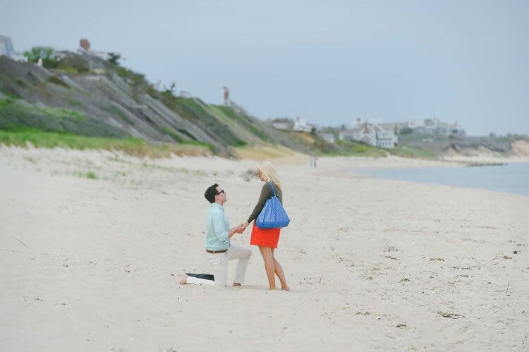 Man proposing to his partner on the beach in Nantucket, USA