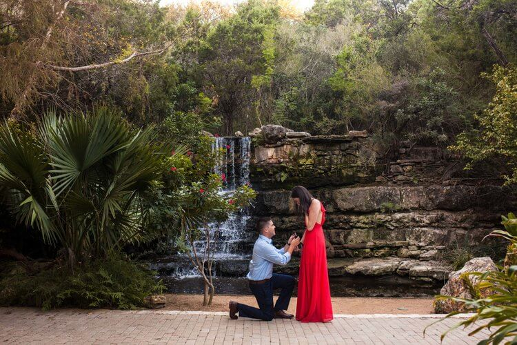 Man proposing to his partner in a park in Austin, Texas USA