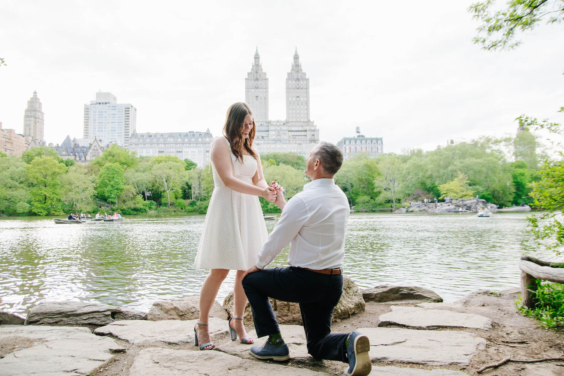 Man proposing to his partner in Central Park, New York City USA