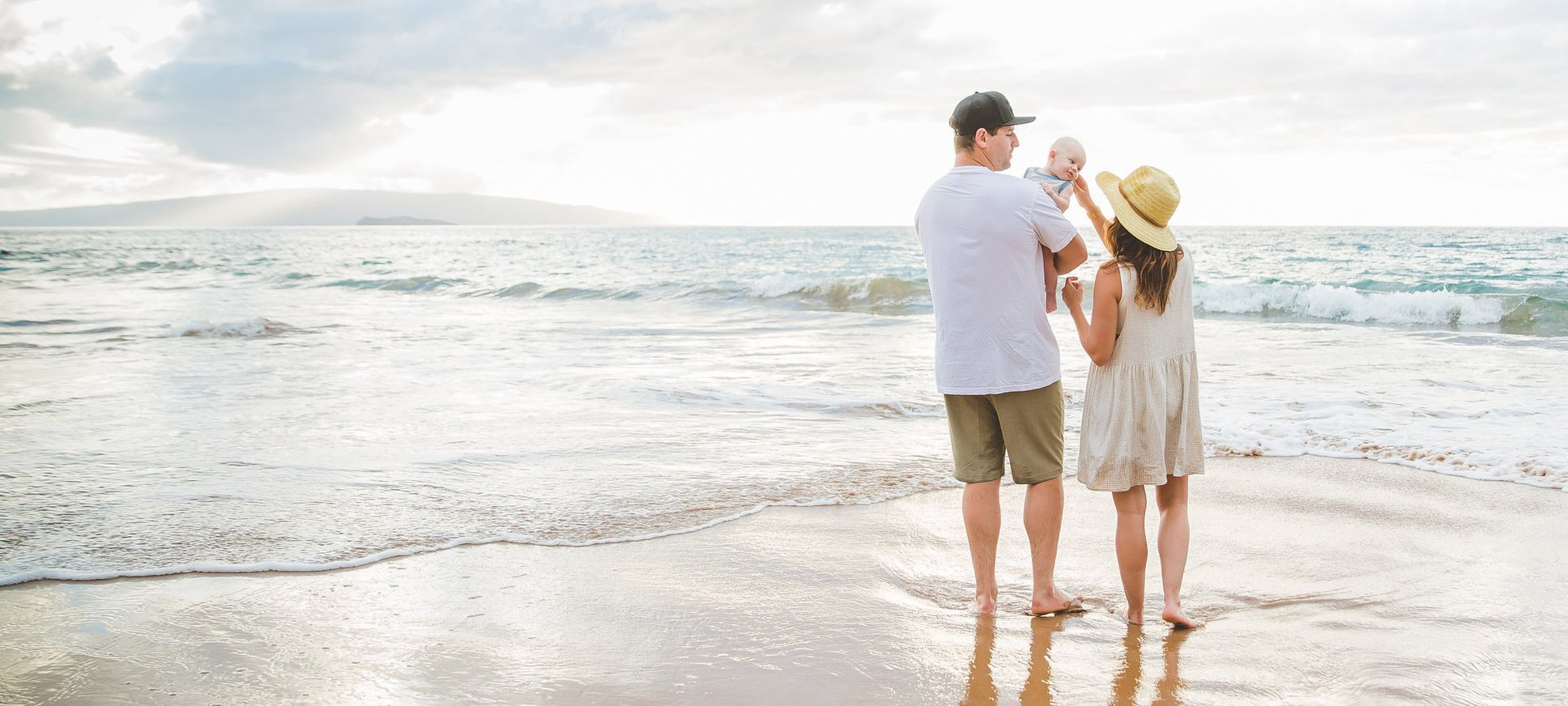 Jillian Harris, her husband and infant son at the beach together on a family photo shoot in Maui