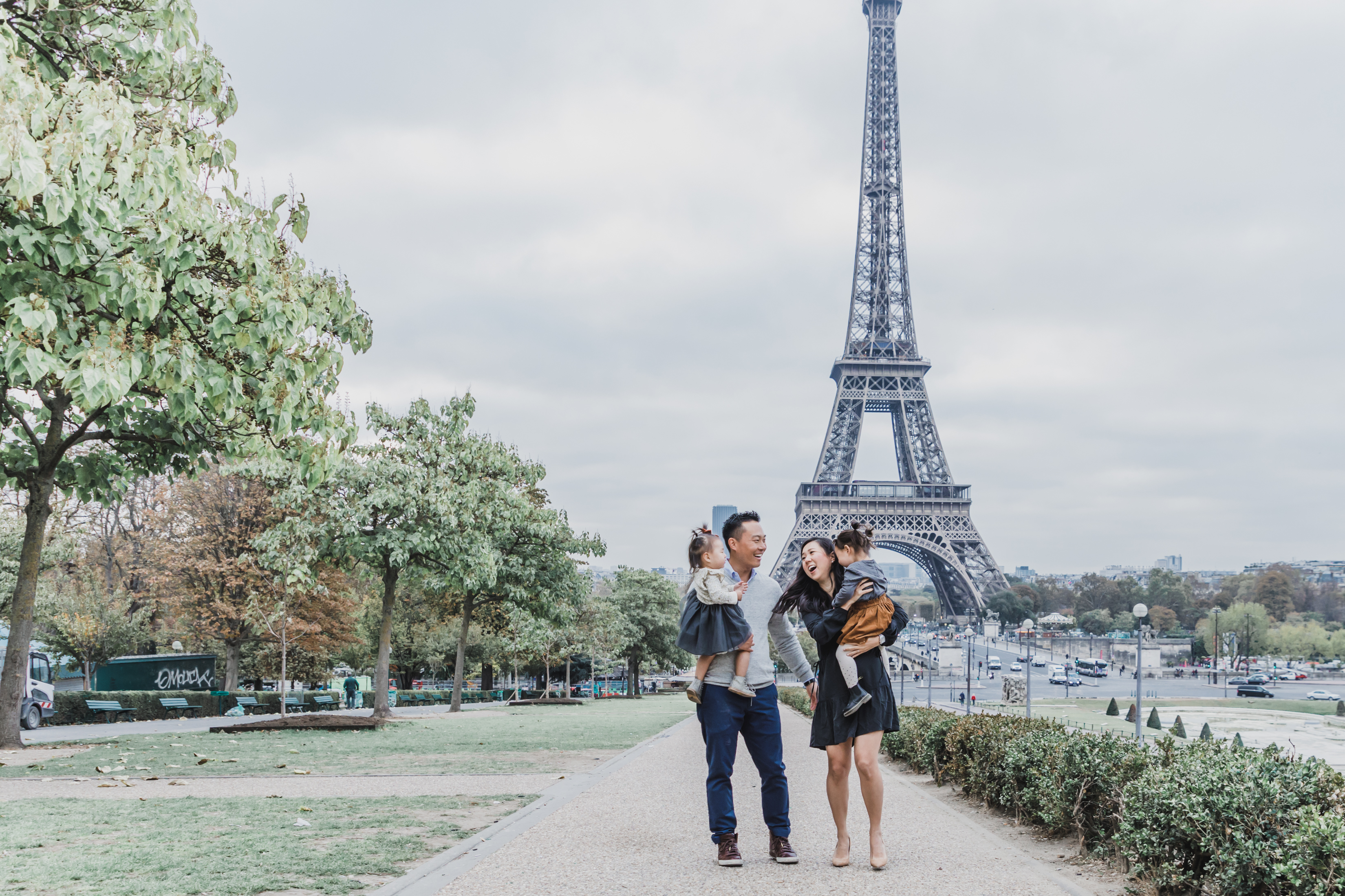 Family of four in front of the Eiffel Tower in Paris, France