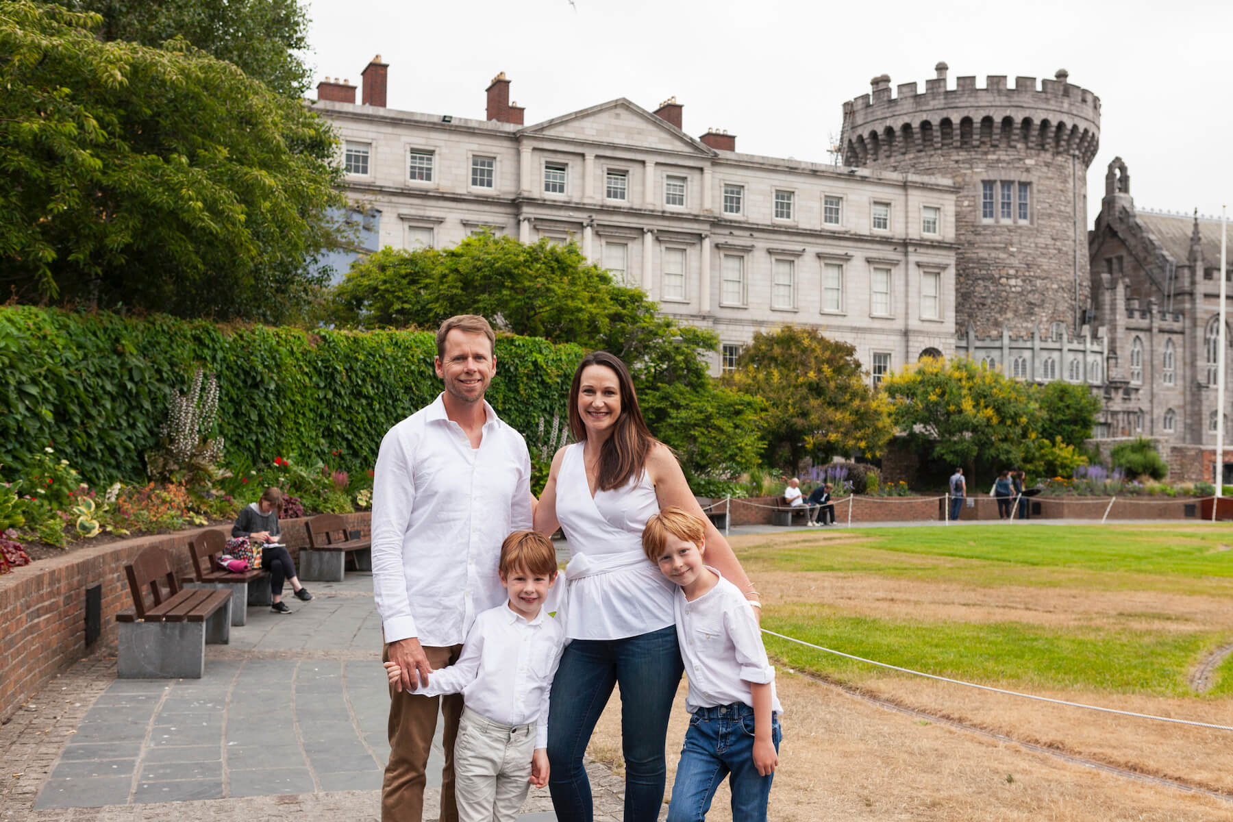 Family standing in front of St Patrick's Cathedral & Dublin Castle Dublin, Ireland