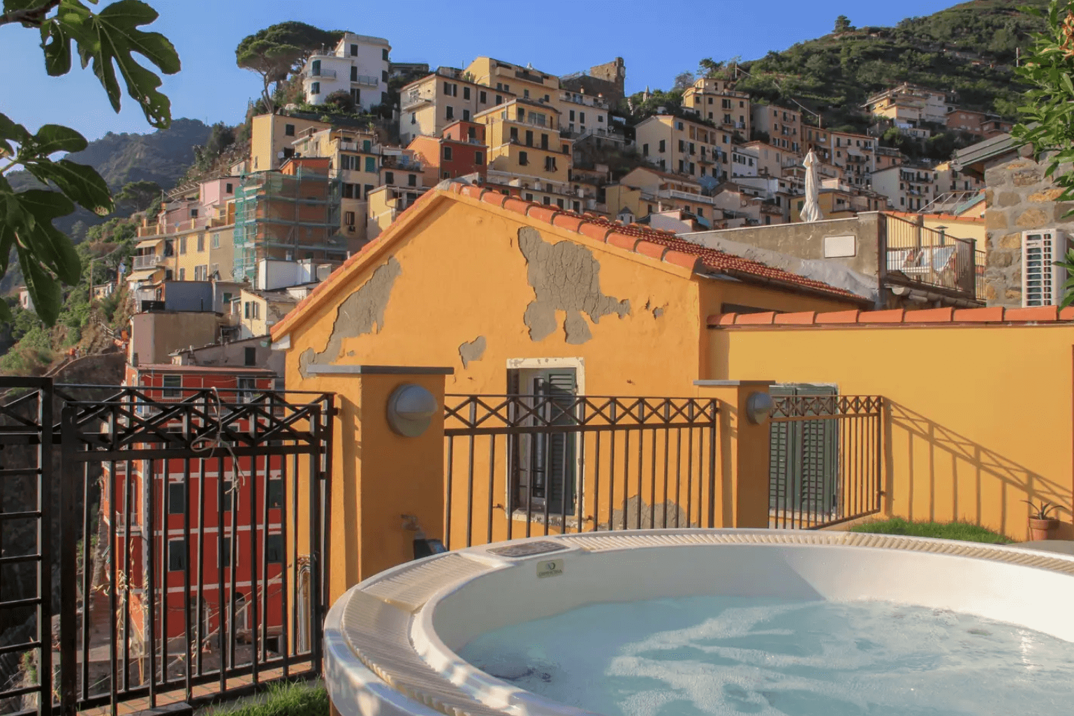 an image of a hot tub on an airbnb balcony overlooking Cinque Terre, Italy
