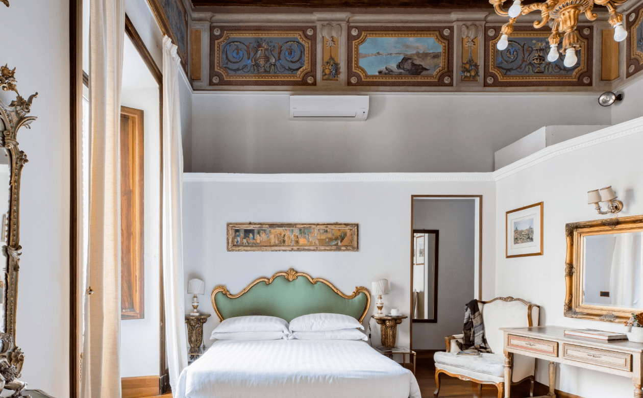 a picture of an airbnb bedroom done in Italian style in Rome, Italy