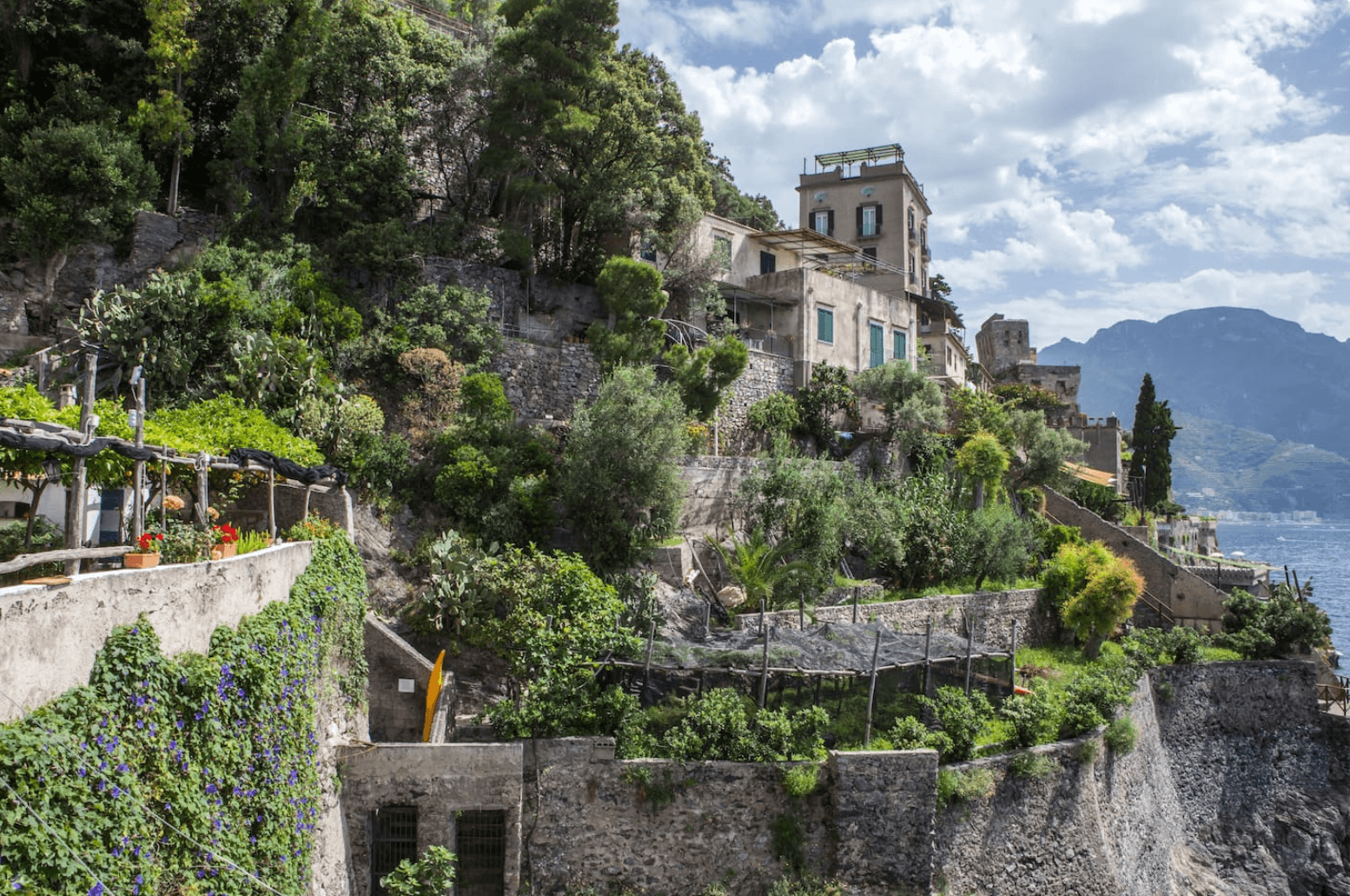 an image an airbnb view of the cliff side in Amalfi Coast, Italy