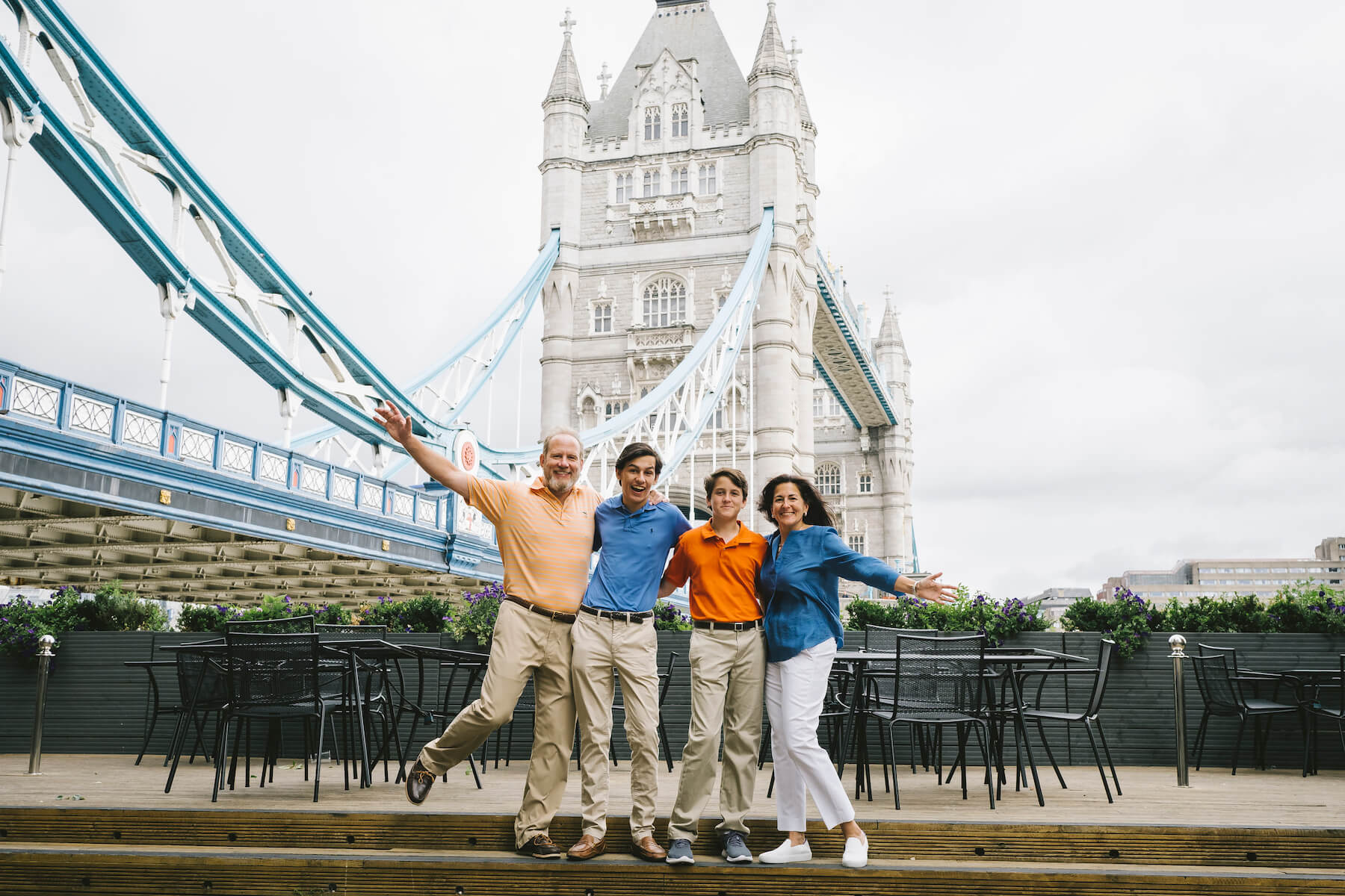 family of four in London, England with the tower bridge in the background