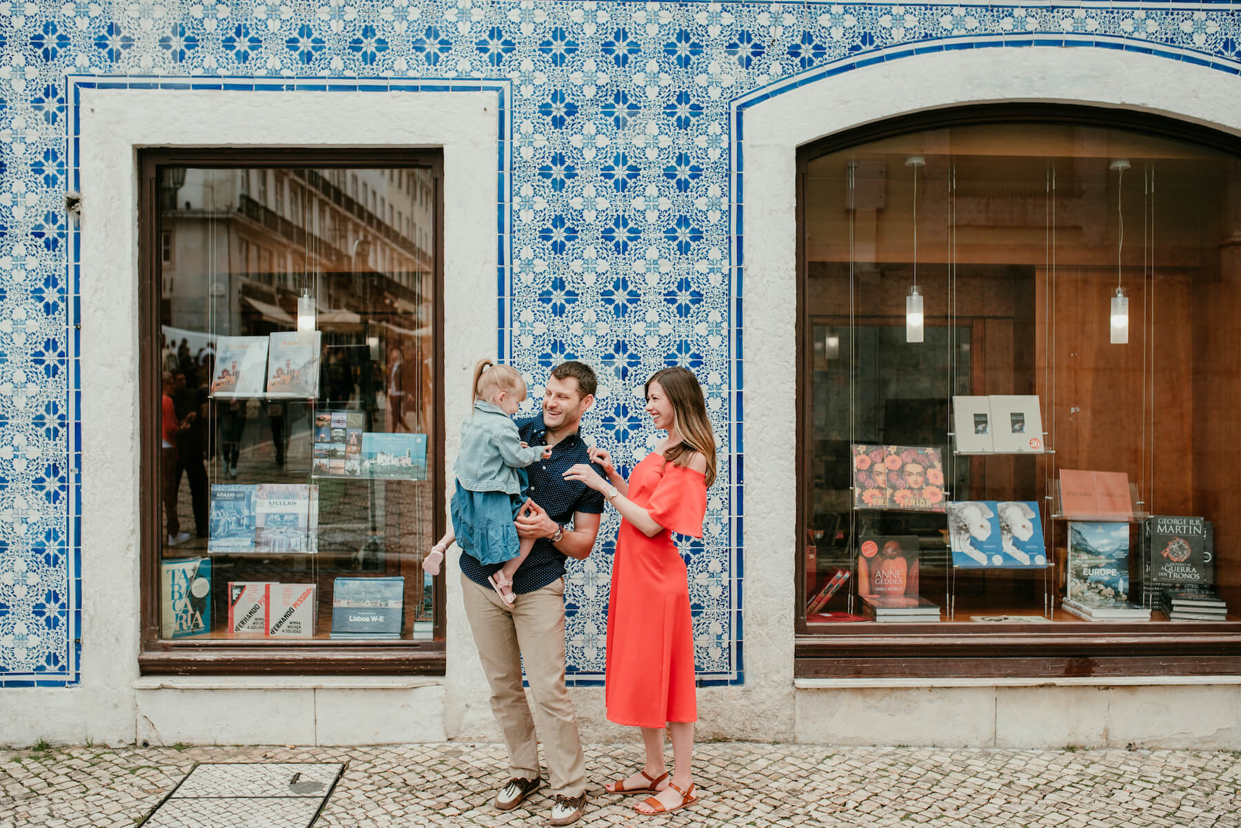 a family standing in front of book store in Lisbon, Portugal
