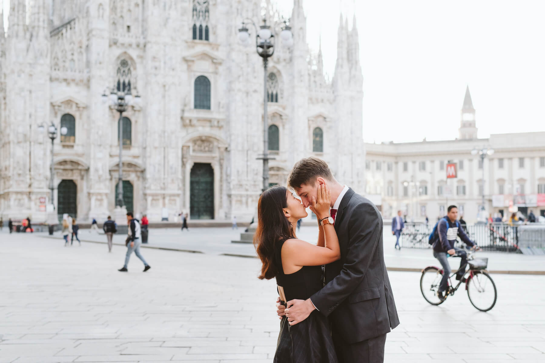 couple holding each other in front of Duomo di Milano, Milan, Italy