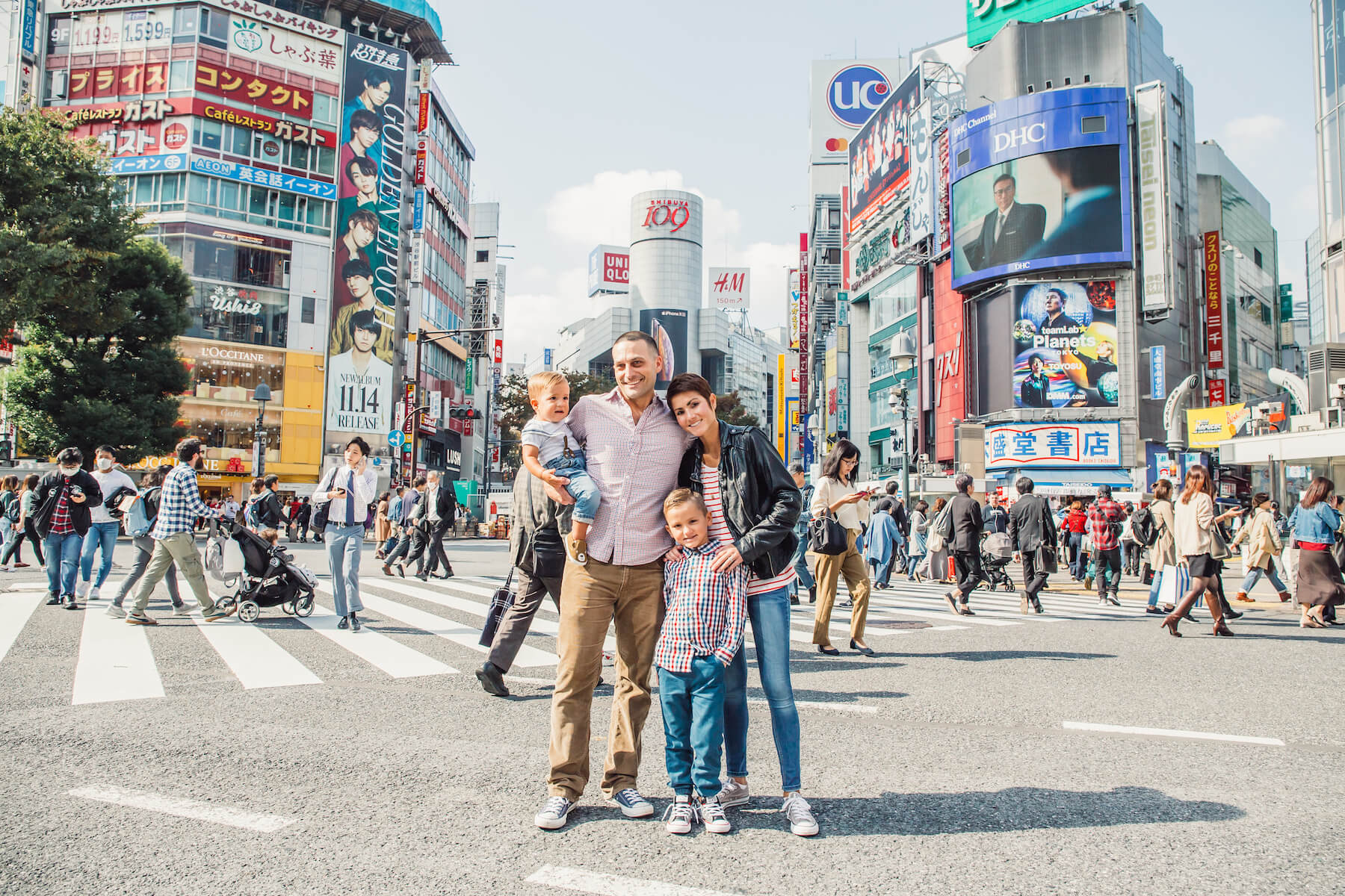 family of four standing for a photo in Tokyo, Japan