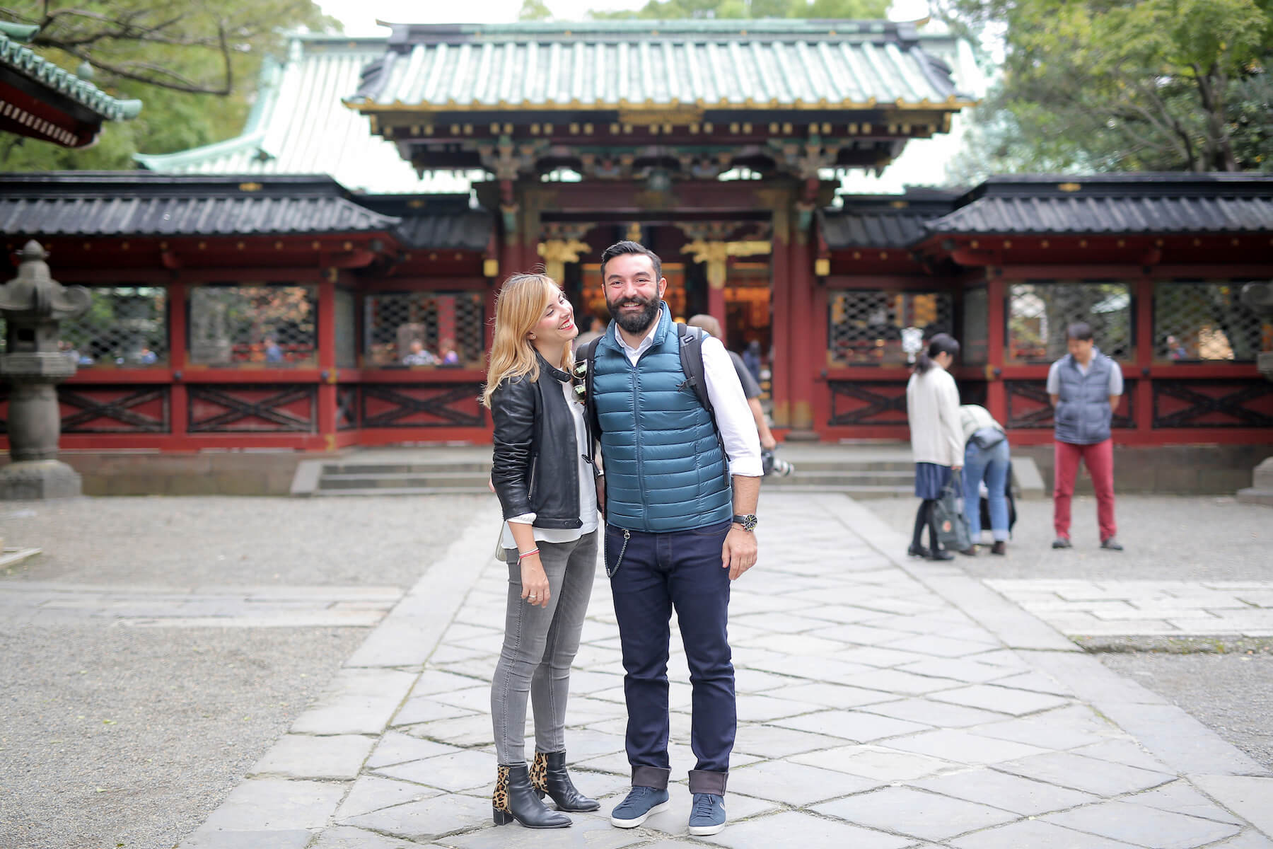 Couple standing in front of a temple in Tokyo, Japan