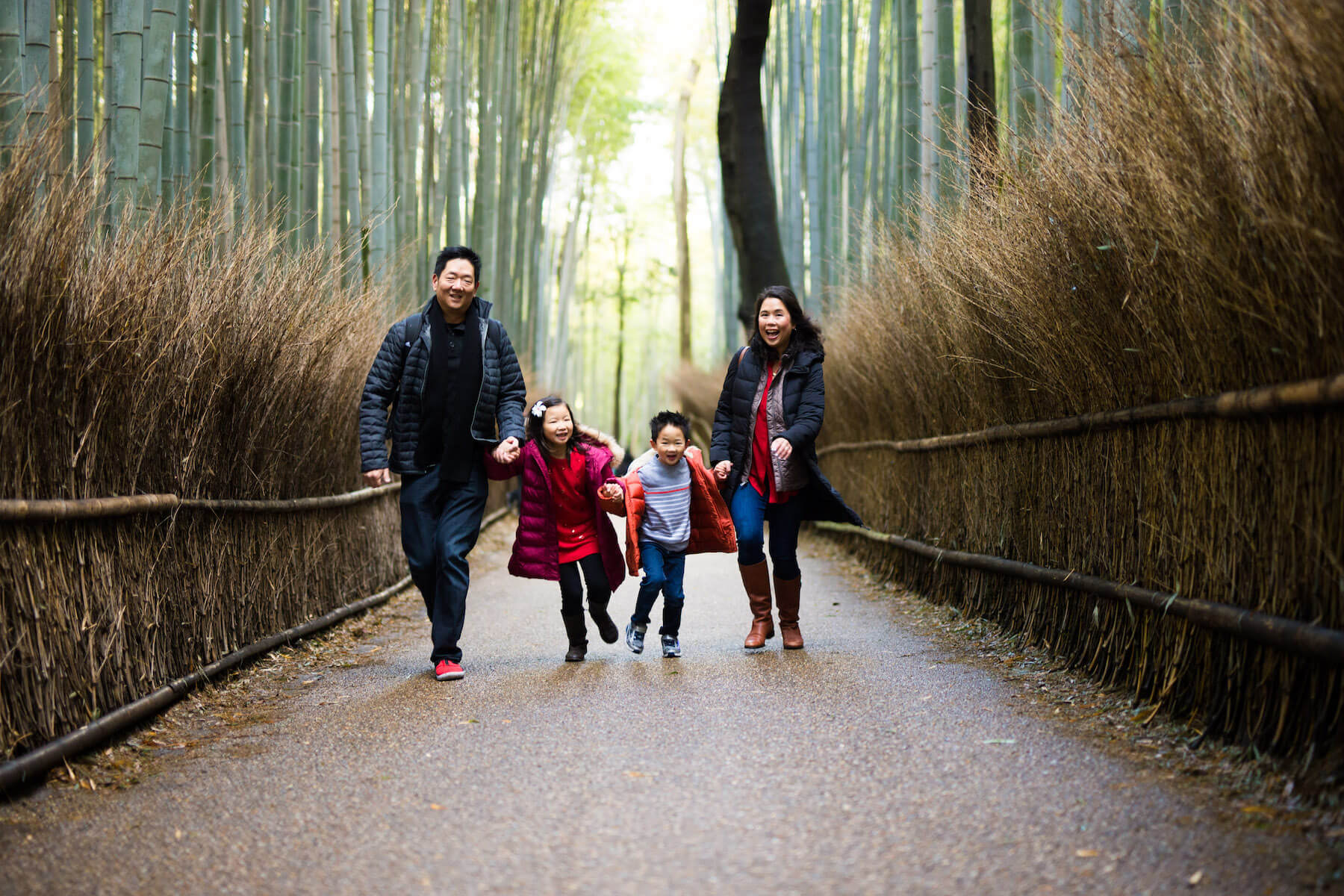 family running in bamboo forest Kyoto Japan