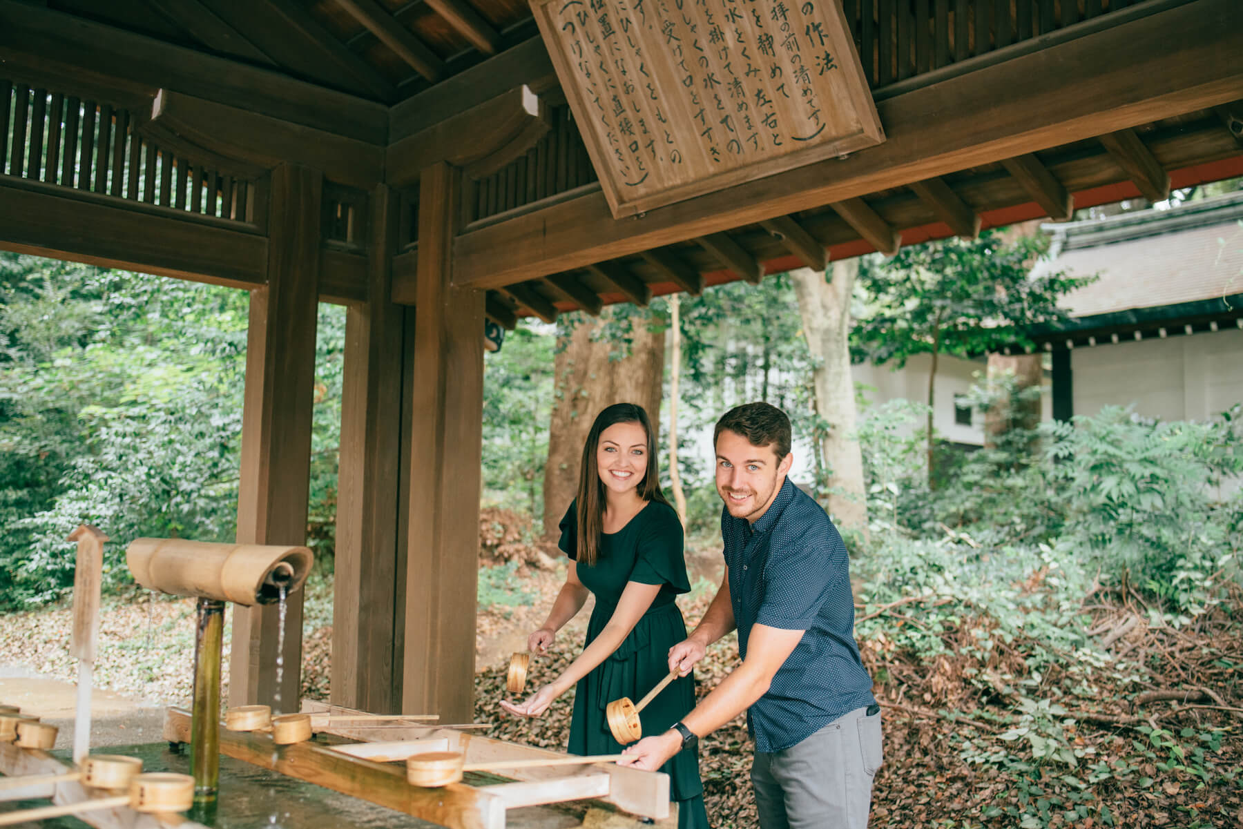 couple getting water at Meiji Shrine, Tokyo Japan