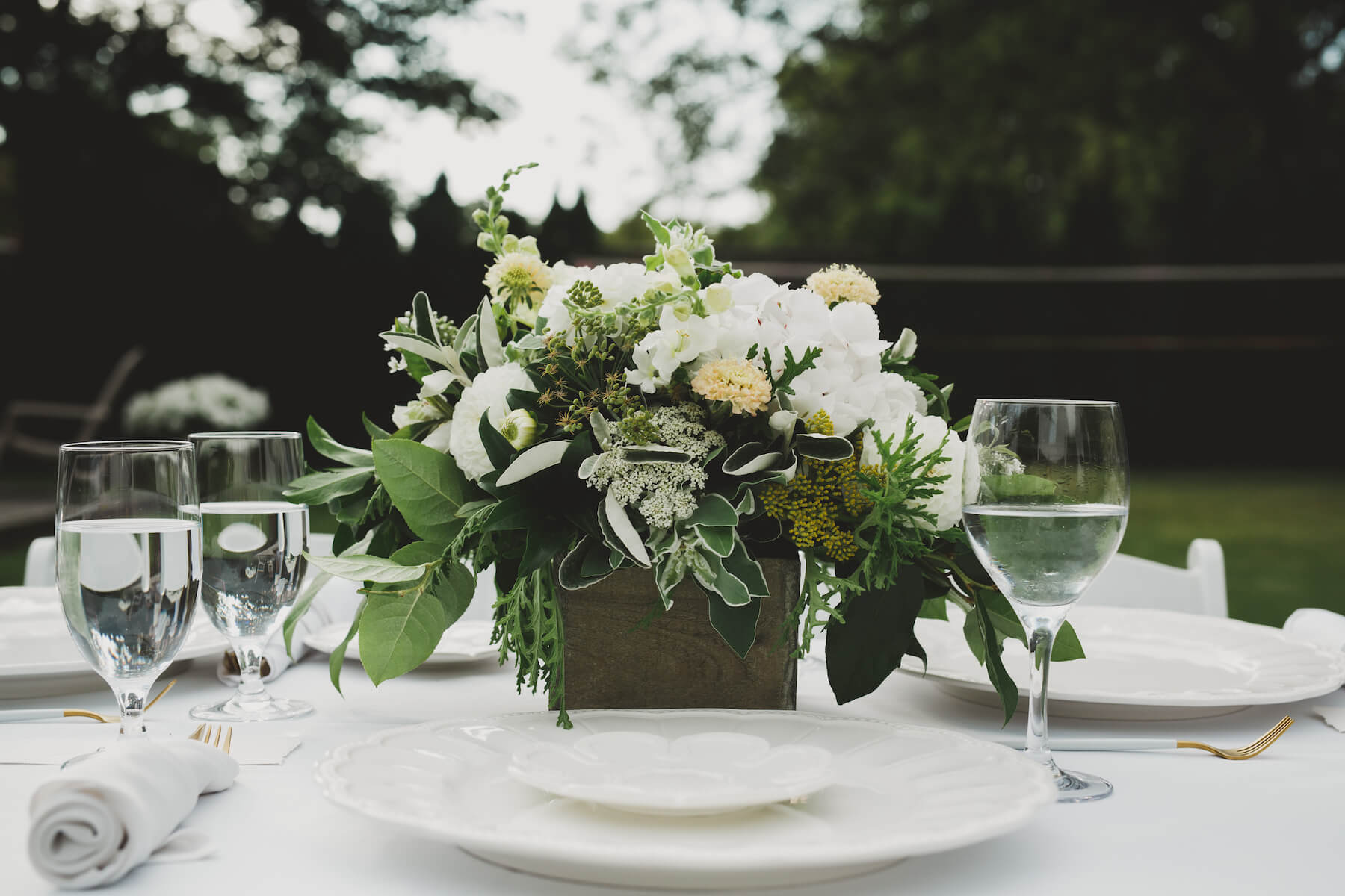 beautiful flower arrangement for garden party table