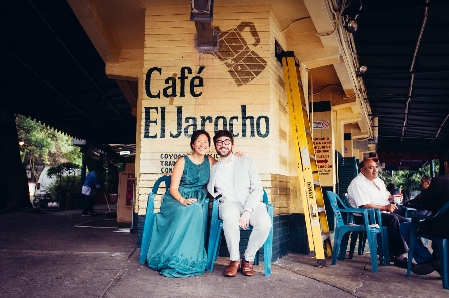 couple in front of a Mexican cafe, sitting down in Mexico City, Mexico