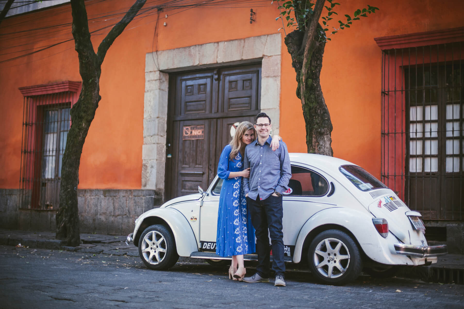 couple hugging each other in front of car in Mexico City, Mexico