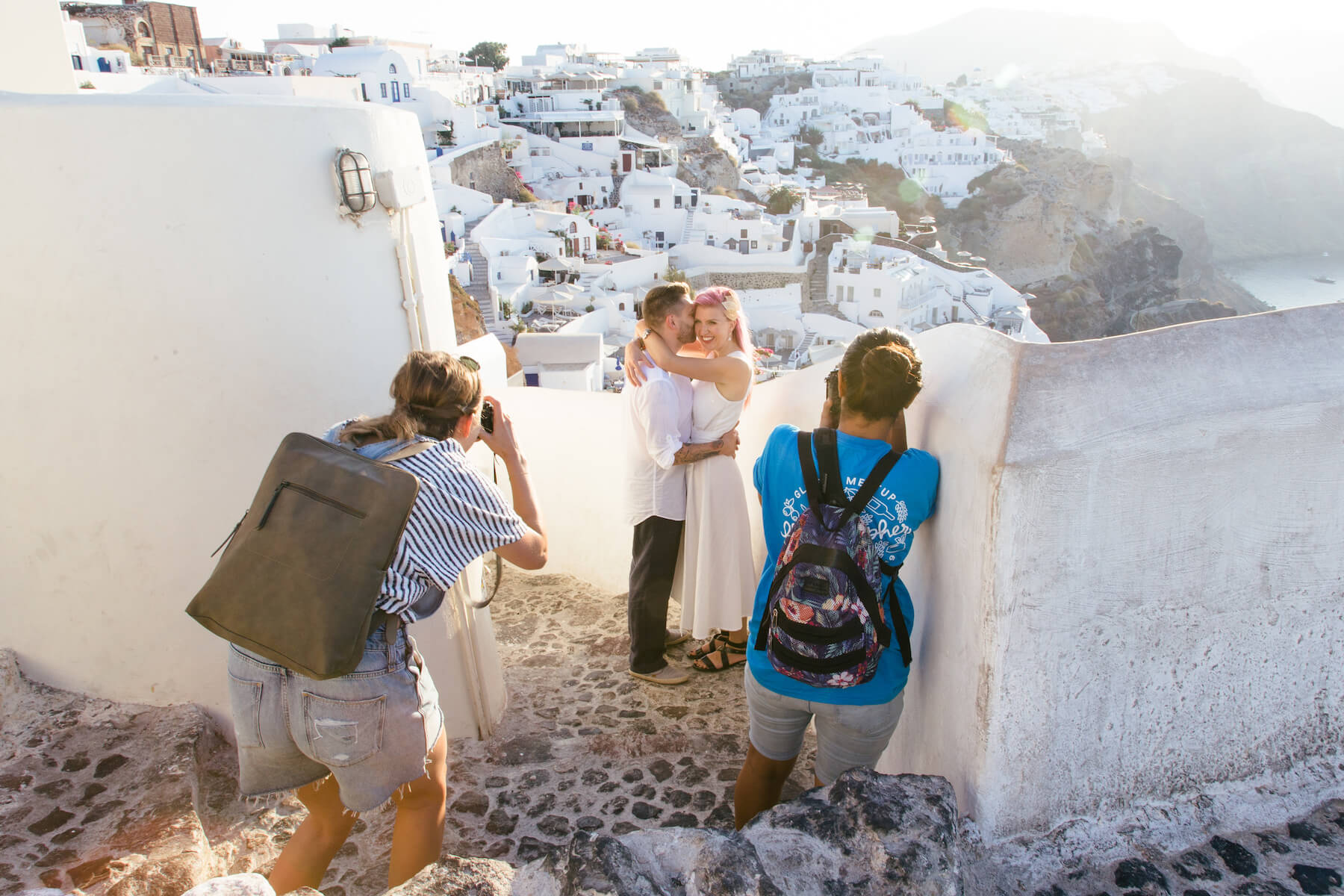 Photographers taking a photo of a couple in Santorini, Greece