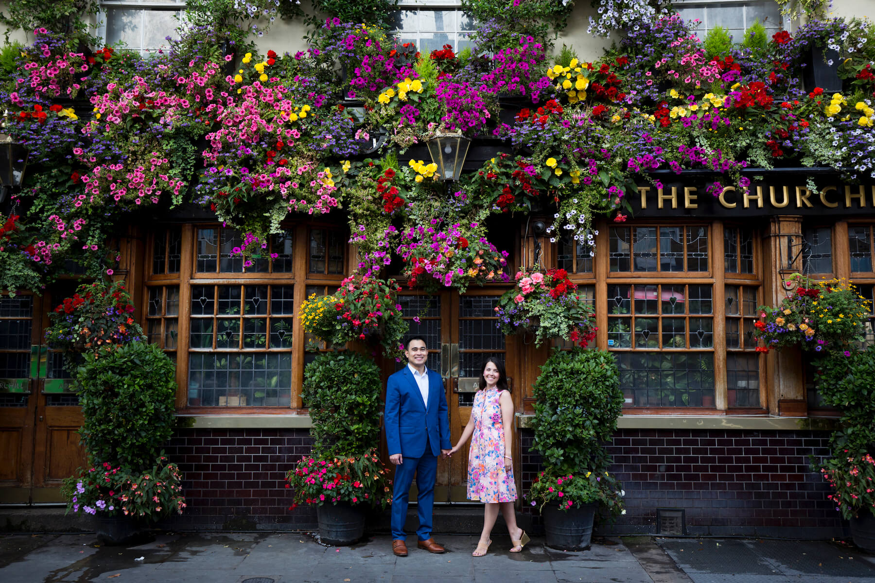couples trip in front of a pub in London, England