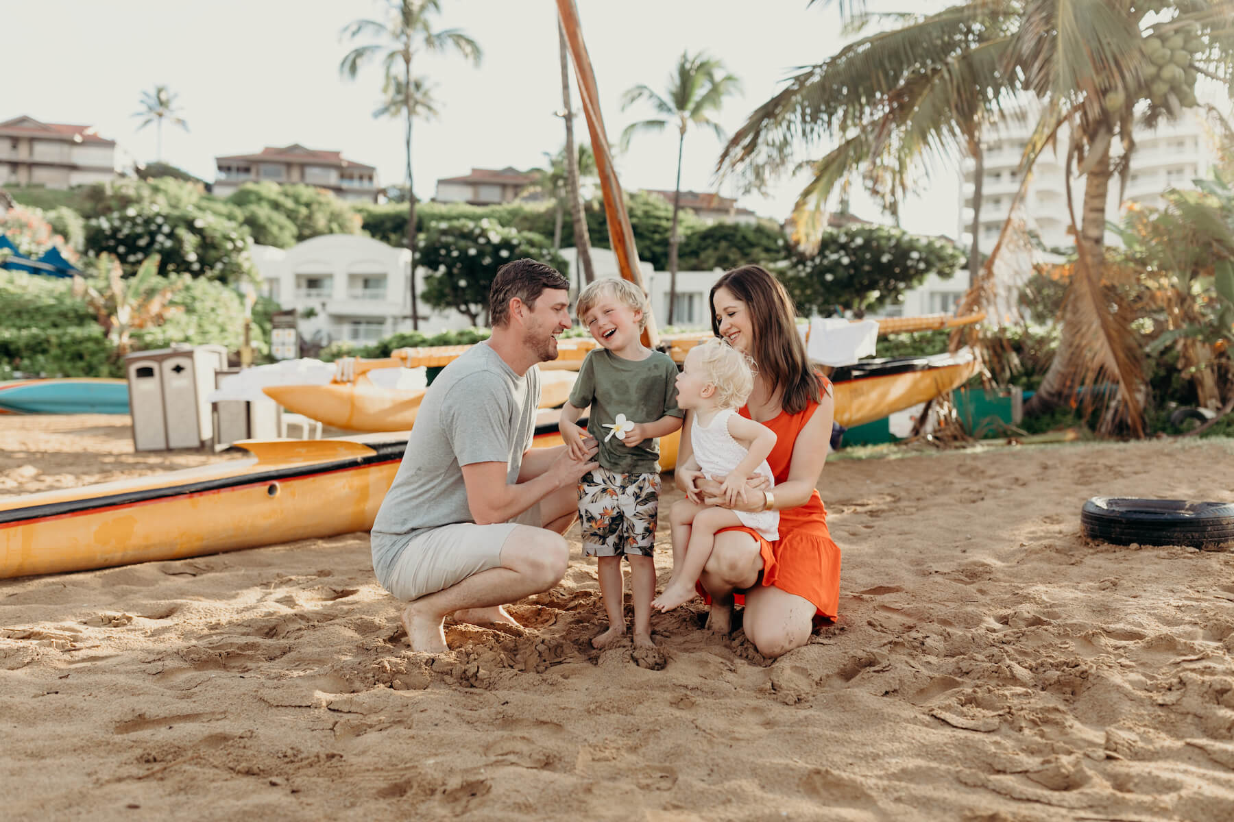 a family of four on the beach in Maui, Hawaii